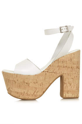 Looker Cork Platforms - predominant colour: white; occasions: casual, creative work; material: leather; ankle detail: ankle strap; heel: block; toe: open toe/peeptoe; style: strappy; finish: plain; pattern: plain; heel height: very high; shoe detail: platform; season: s/s 2014