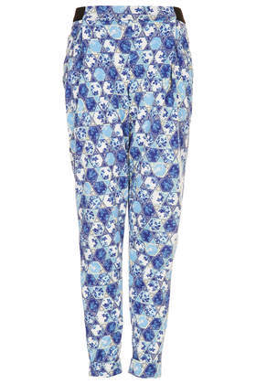 Tile Floral Tapered Trousers - length: standard; style: peg leg; waist: mid/regular rise; secondary colour: ivory/cream; predominant colour: royal blue; occasions: casual, creative work; fibres: polyester/polyamide - 100%; fit: tapered; pattern type: fabric; pattern: florals; texture group: other - light to midweight; trends: furious florals; season: s/s 2014; pattern size: standard (bottom)