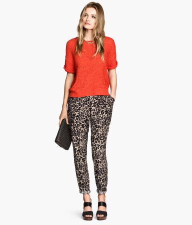 Trousers Loose Fit - style: peg leg; waist: mid/regular rise; predominant colour: camel; secondary colour: black; occasions: casual, creative work; length: ankle length; fibres: viscose/rayon - 100%; fit: slim leg; pattern type: fabric; pattern: animal print; texture group: other - light to midweight; season: s/s 2014; pattern size: standard (bottom)