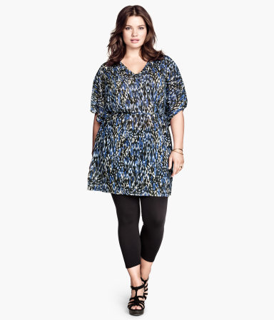 + Jersey Tunic - neckline: v-neck; waist detail: elasticated waist; length: below the bottom; style: tunic; predominant colour: navy; occasions: casual, creative work; fibres: polyester/polyamide - 100%; fit: loose; sleeve length: half sleeve; sleeve style: standard; pattern type: fabric; pattern: patterned/print; texture group: jersey - stretchy/drapey; season: s/s 2014; pattern size: big & busy (top)