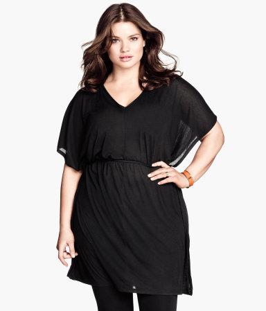 + Jersey Tunic - neckline: v-neck; sleeve style: dolman/batwing; pattern: plain; waist detail: elasticated waist; style: tunic; predominant colour: black; occasions: casual, evening, creative work; fibres: polyester/polyamide - 100%; fit: loose; length: mid thigh; sleeve length: half sleeve; pattern type: fabric; texture group: jersey - stretchy/drapey; season: s/s 2014