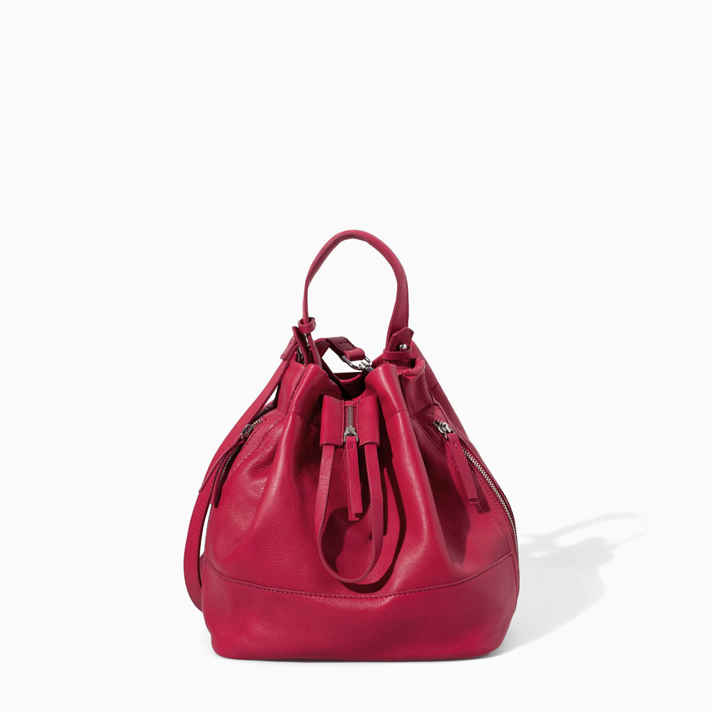 Leather Bucket Bag - occasions: casual, creative work; type of pattern: standard; style: onion bag; length: across body/long; size: oversized; material: leather; embellishment: zips; pattern: plain; finish: plain; predominant colour: raspberry; season: s/s 2014