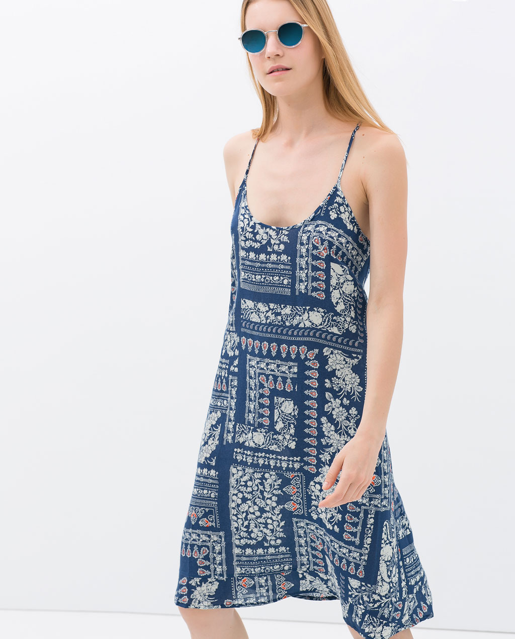 Printed Dress - sleeve style: spaghetti straps; fit: loose; secondary colour: ivory/cream; predominant colour: denim; occasions: casual, holiday; length: on the knee; style: slip dress; neckline: scoop; fibres: viscose/rayon - 100%; sleeve length: sleeveless; pattern type: fabric; pattern size: standard; pattern: patterned/print; texture group: other - light to midweight; trends: world traveller; season: s/s 2014