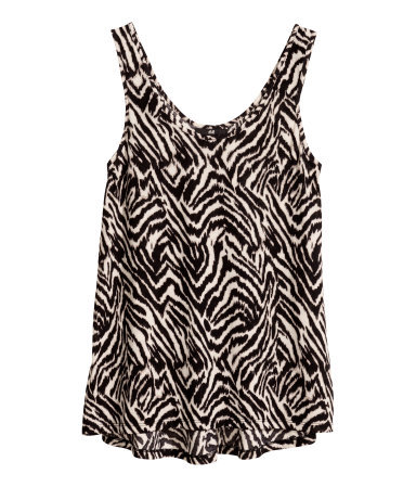 Jersey Top - neckline: low v-neck; sleeve style: sleeveless; secondary colour: ivory/cream; predominant colour: black; occasions: casual; length: standard; style: top; fit: body skimming; sleeve length: sleeveless; pattern type: fabric; pattern size: standard; pattern: patterned/print; texture group: jersey - stretchy/drapey; trends: world traveller; season: s/s 2014