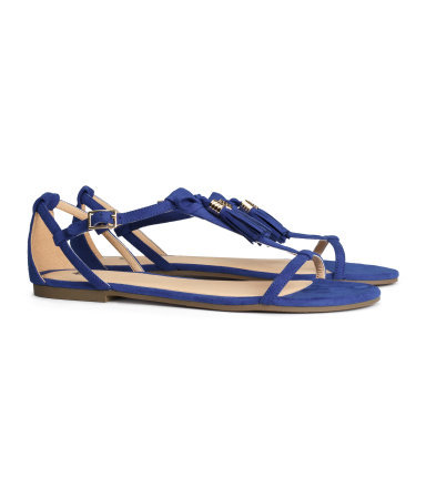 Sandals With Tassels - predominant colour: royal blue; secondary colour: gold; occasions: casual, holiday; heel height: flat; embellishment: tassels; heel: standard; toe: open toe/peeptoe; style: standard; finish: plain; pattern: plain; material: faux suede; trends: hot brights; season: s/s 2014