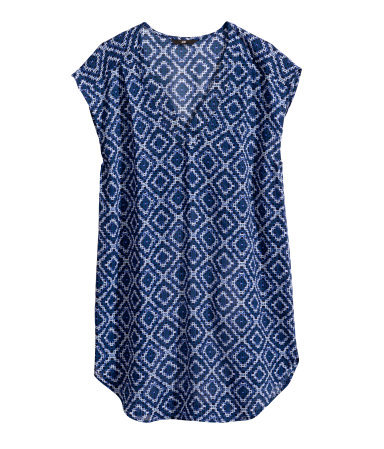 Sleeveless Blouse - neckline: low v-neck; sleeve style: capped; length: below the bottom; secondary colour: pale blue; predominant colour: navy; occasions: casual, creative work; style: top; fibres: polyester/polyamide - 100%; fit: loose; sleeve length: short sleeve; texture group: sheer fabrics/chiffon/organza etc.; pattern type: fabric; pattern size: standard; pattern: patterned/print; season: s/s 2014