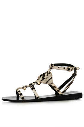 Feery Skinny Strap Sandals - predominant colour: ivory/cream; secondary colour: black; occasions: casual, holiday; material: leather; heel height: flat; ankle detail: ankle strap; heel: standard; toe: open toe/peeptoe; style: strappy; finish: plain; pattern: animal print; trends: world traveller; season: s/s 2014