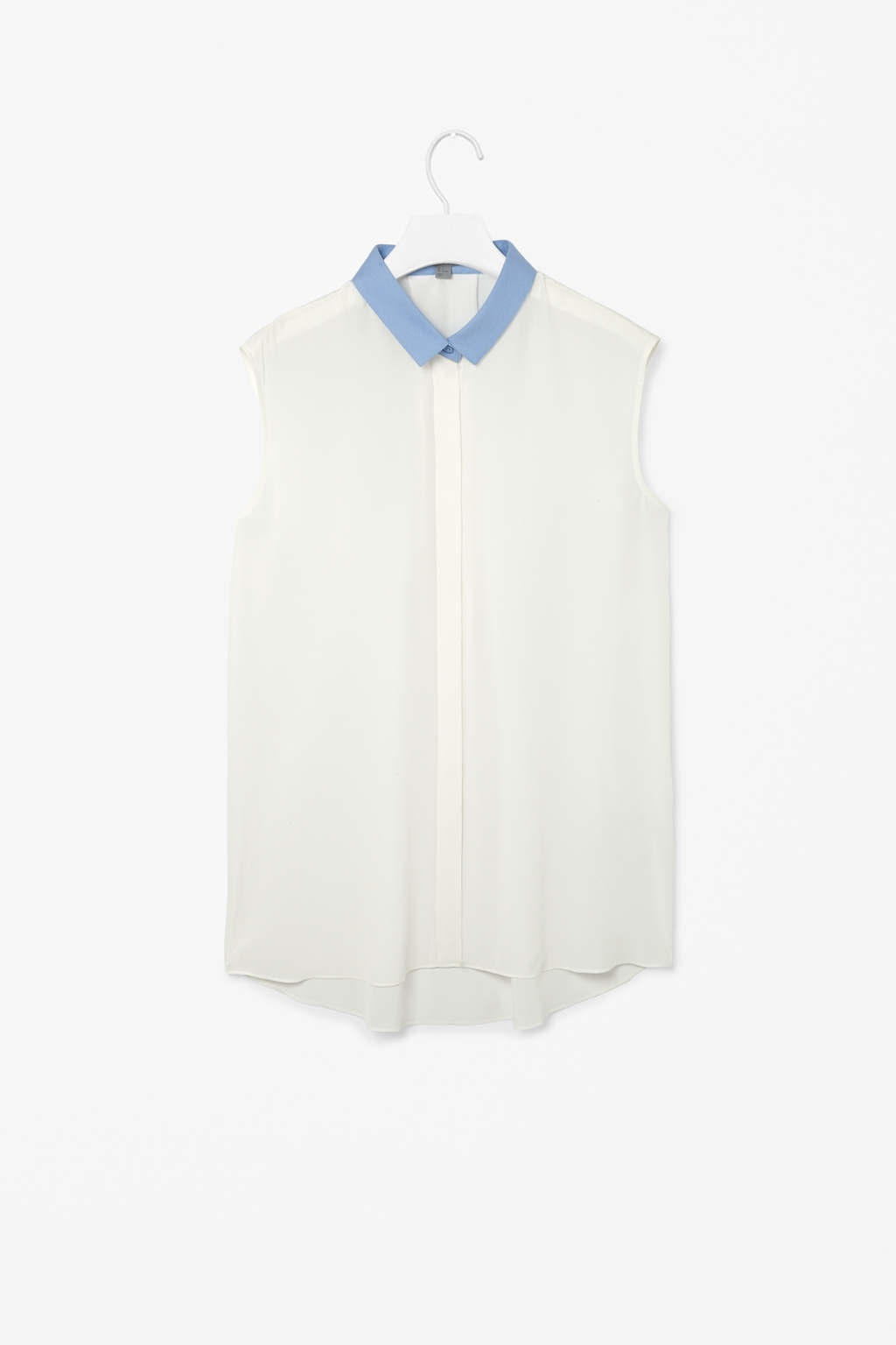 Sleeveless Silk Shirt - neckline: shirt collar/peter pan/zip with opening; sleeve style: sleeveless; style: shirt; predominant colour: white; secondary colour: pale blue; occasions: casual, evening, creative work; length: standard; fibres: silk - 100%; fit: straight cut; sleeve length: sleeveless; texture group: silky - light; pattern type: fabric; pattern size: standard; pattern: colourblock; trends: sheer; season: s/s 2014