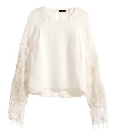 Embroidered Blouse - neckline: round neck; sleeve style: raglan; pattern: plain; predominant colour: ivory/cream; occasions: casual, evening, creative work; length: standard; style: top; fibres: viscose/rayon - 100%; fit: straight cut; sleeve length: long sleeve; texture group: sheer fabrics/chiffon/organza etc.; pattern type: fabric; embellishment: embroidered; trends: lace; season: s/s 2014