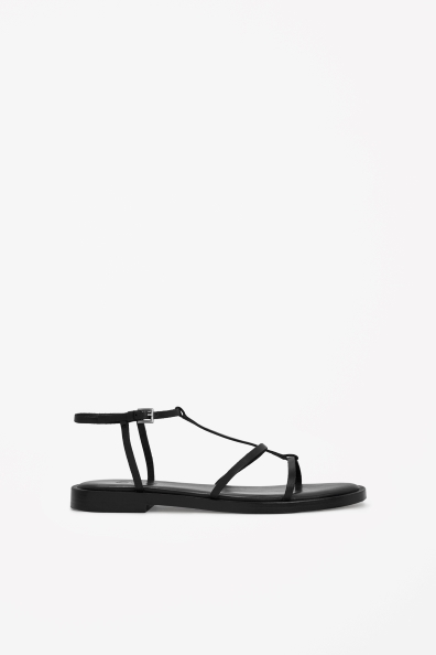 Slim Strap Sandals - predominant colour: black; occasions: casual, holiday; material: leather; heel height: flat; ankle detail: ankle strap; heel: standard; toe: open toe/peeptoe; style: standard; finish: plain; pattern: plain; season: s/s 2014