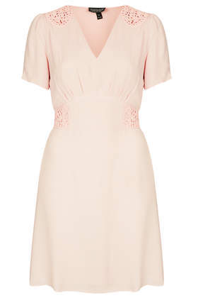 Cornelli Tea Dress - style: shift; length: mid thigh; neckline: v-neck; pattern: plain; waist detail: embellishment at waist/feature waistband; predominant colour: nude; occasions: casual, evening; fit: fitted at waist & bust; fibres: viscose/rayon - 100%; shoulder detail: added shoulder detail; sleeve length: short sleeve; sleeve style: standard; pattern type: fabric; texture group: other - light to midweight; trends: sorbet shades; season: s/s 2014