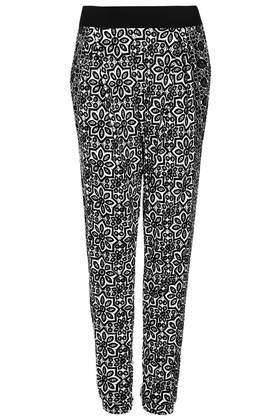 Petite Mixed Tile Print Jersey Tapered Trousers - length: standard; style: tracksuit pants; waist: mid/regular rise; secondary colour: white; predominant colour: black; occasions: casual, creative work; fibres: polyester/polyamide - 100%; fit: tapered; pattern type: fabric; pattern: patterned/print; texture group: jersey - stretchy/drapey; season: s/s 2014; trends: monochrome; pattern size: big & busy (bottom)