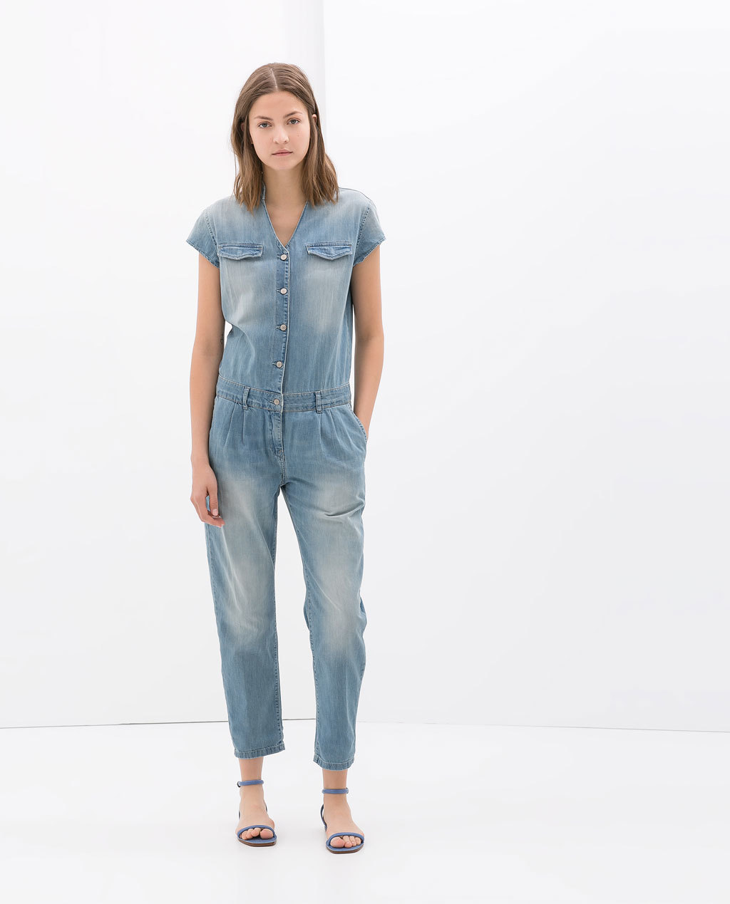 Short Sleeve Denim Jumpsuit - neckline: v-neck; sleeve style: capped; pattern: plain; bust detail: buttons at bust (in middle at breastbone)/zip detail at bust; predominant colour: denim; occasions: casual; length: ankle length; fit: body skimming; fibres: cotton - 100%; sleeve length: short sleeve; texture group: denim; style: jumpsuit; pattern type: fabric; season: s/s 2014