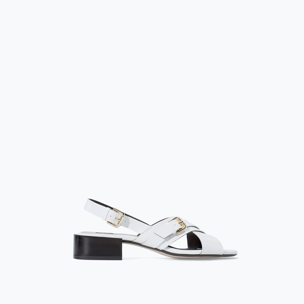 Cross Strap Sandal With Tortoiseshell Heel - predominant colour: white; secondary colour: black; occasions: casual, holiday; material: faux leather; heel height: mid; embellishment: buckles; heel: block; toe: open toe/peeptoe; style: standard; finish: patent; pattern: colourblock; season: s/s 2014