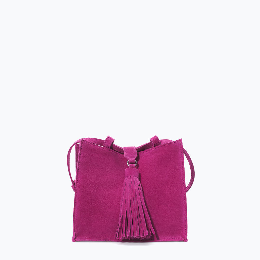Suede Messenger Bag With Tassel - predominant colour: hot pink; occasions: casual, creative work; type of pattern: standard; style: messenger; length: across body/long; size: standard; material: suede; embellishment: tassels; pattern: plain; finish: plain; season: s/s 2014
