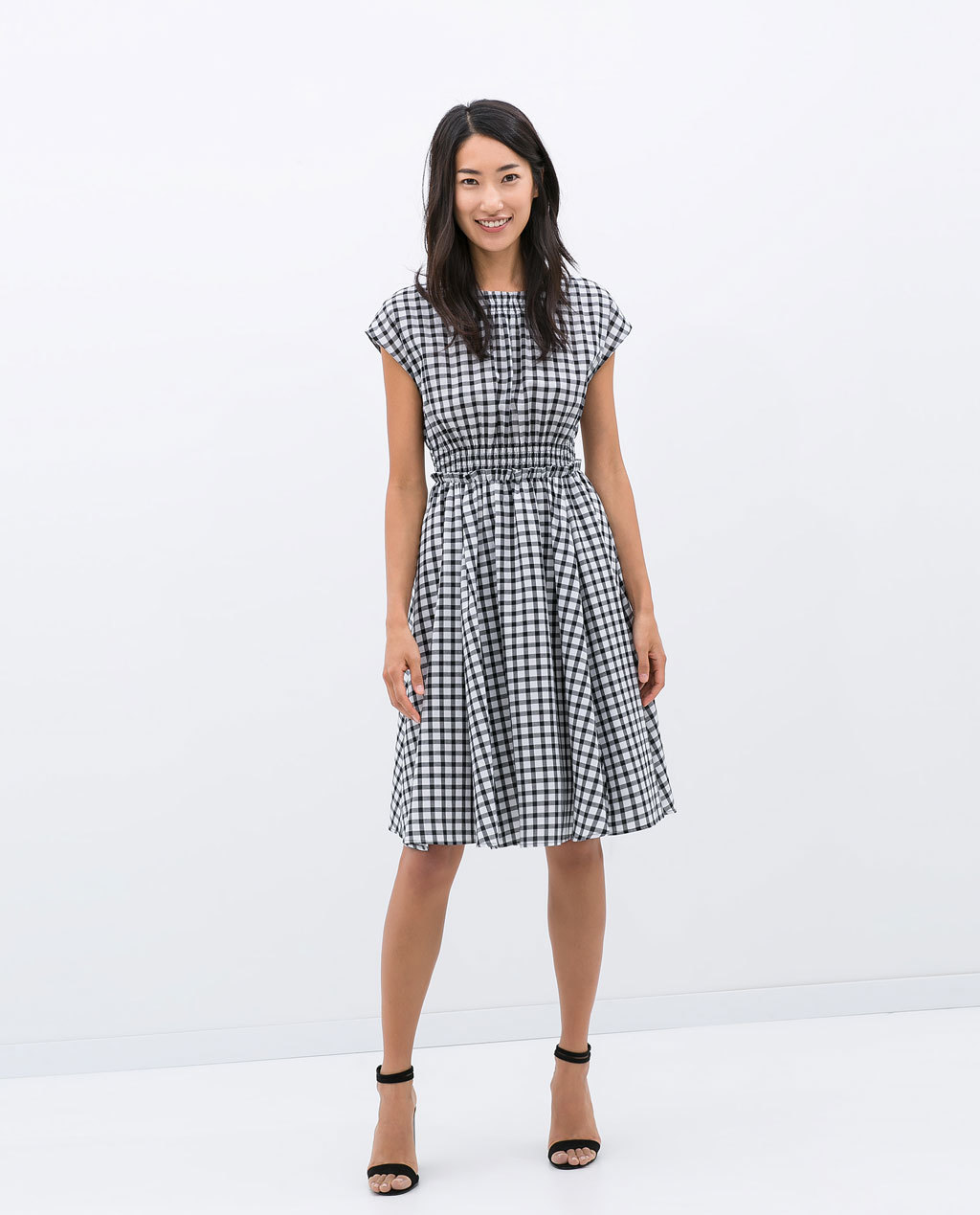 Checkered Dress With Elastic Waist - style: tea dress; neckline: round neck; sleeve style: capped; pattern: checked/gingham; waist detail: elasticated waist; secondary colour: white; predominant colour: black; occasions: casual, occasion, creative work; length: on the knee; fit: fitted at waist & bust; fibres: cotton - 100%; hip detail: adds bulk at the hips; sleeve length: short sleeve; texture group: cotton feel fabrics; pattern type: fabric; pattern size: big & busy; season: s/s 2014; trends: monochrome