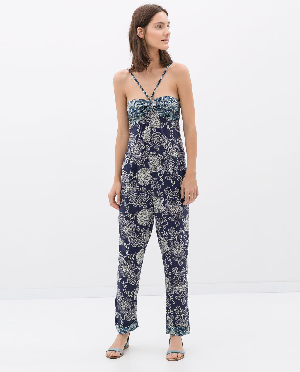 Flower Print Jumpsuit - sleeve style: sleeveless; neckline: low halter neck; predominant colour: navy; occasions: casual, holiday; length: ankle length; fit: body skimming; fibres: viscose/rayon - 100%; sleeve length: sleeveless; style: jumpsuit; pattern type: fabric; pattern size: big & busy; pattern: florals; texture group: other - light to midweight; season: s/s 2014
