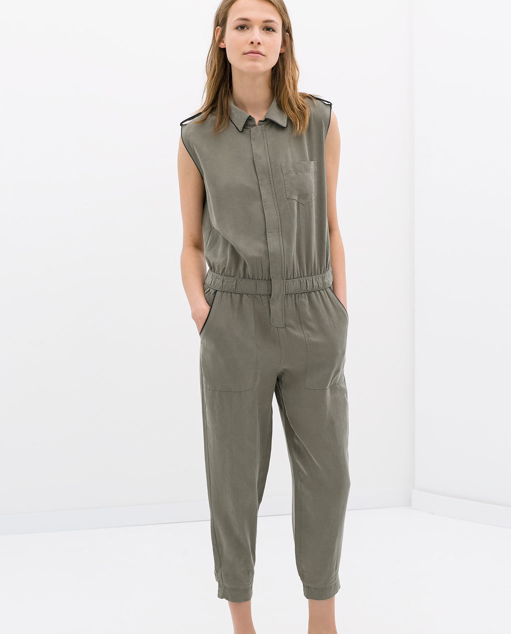 Jumpsuit - neckline: shirt collar/peter pan/zip with opening; fit: fitted at waist; pattern: plain; sleeve style: sleeveless; waist detail: elasticated waist; predominant colour: khaki; occasions: casual, holiday; length: calf length; shoulder detail: discreet epaulette; sleeve length: sleeveless; style: jumpsuit; pattern type: fabric; texture group: other - light to midweight; season: s/s 2014
