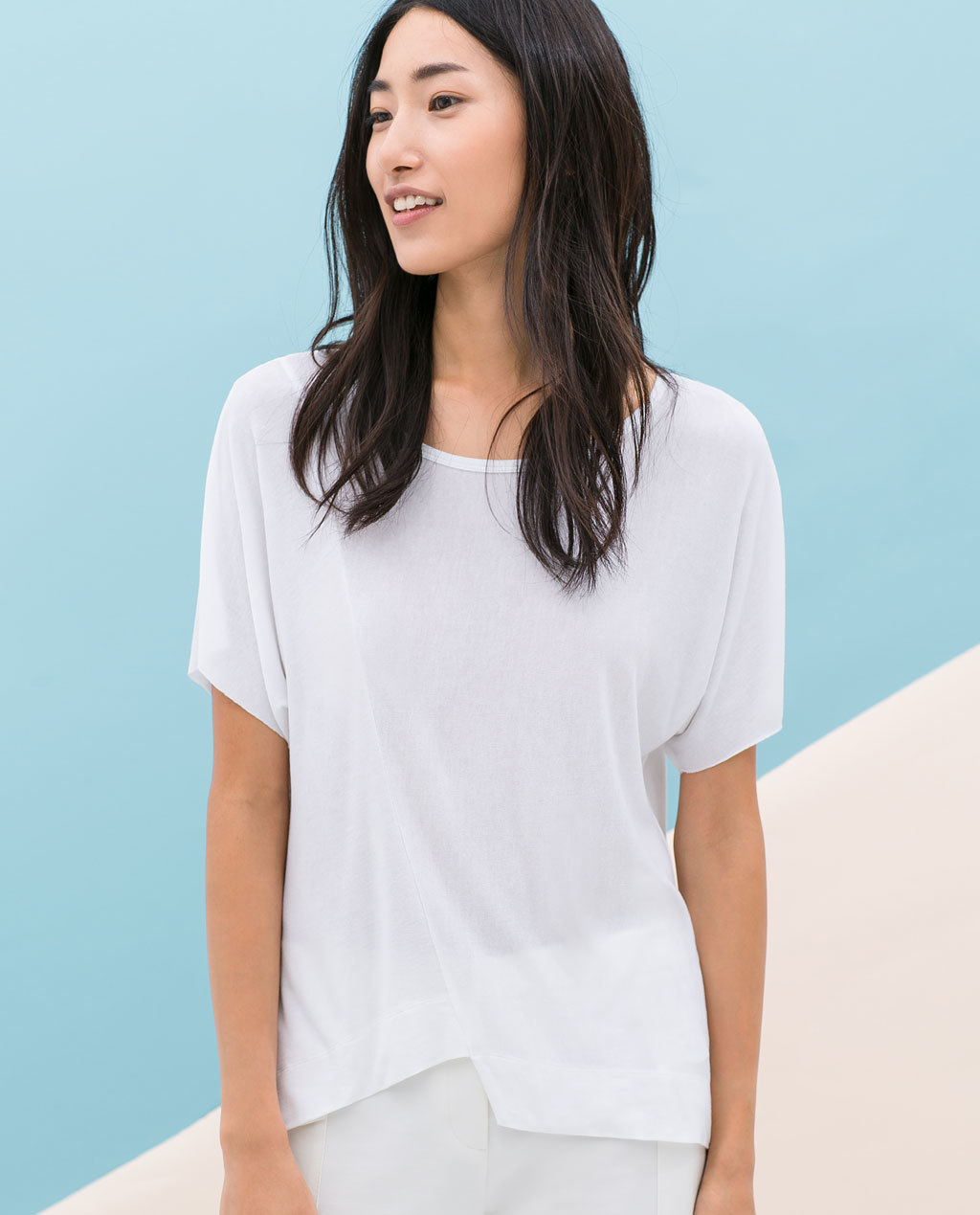Top With Asymmetric Hem - neckline: round neck; sleeve style: dolman/batwing; pattern: plain; style: t-shirt; predominant colour: white; occasions: casual, creative work; length: standard; fibres: viscose/rayon - stretch; fit: loose; sleeve length: short sleeve; pattern type: fabric; texture group: jersey - stretchy/drapey; season: s/s 2014