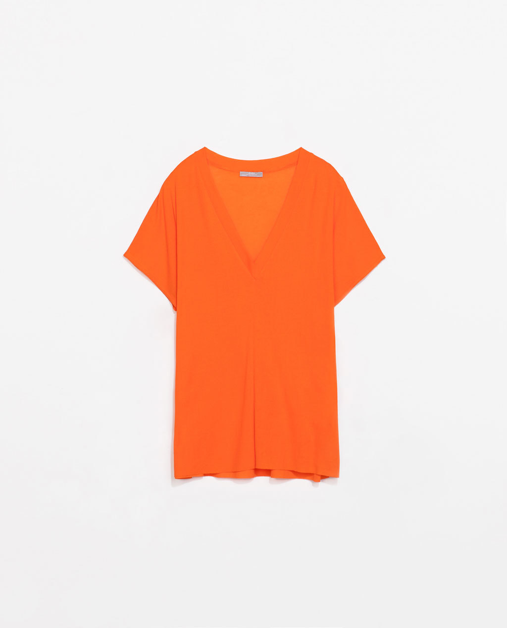 V Neck T Shirt - neckline: low v-neck; pattern: plain; style: t-shirt; predominant colour: bright orange; occasions: casual; length: standard; fibres: cotton - 100%; fit: loose; sleeve length: short sleeve; sleeve style: standard; pattern type: fabric; texture group: jersey - stretchy/drapey; trends: hot brights; season: s/s 2014