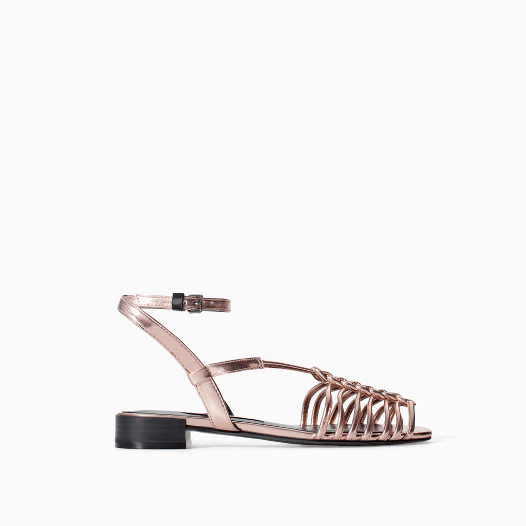 Crossover Shiny Sandals - predominant colour: gold; occasions: casual, holiday, creative work; material: faux leather; heel height: flat; ankle detail: ankle strap; heel: standard; toe: open toe/peeptoe; style: strappy; finish: metallic; pattern: plain; trends: shimmery metallics; season: s/s 2014