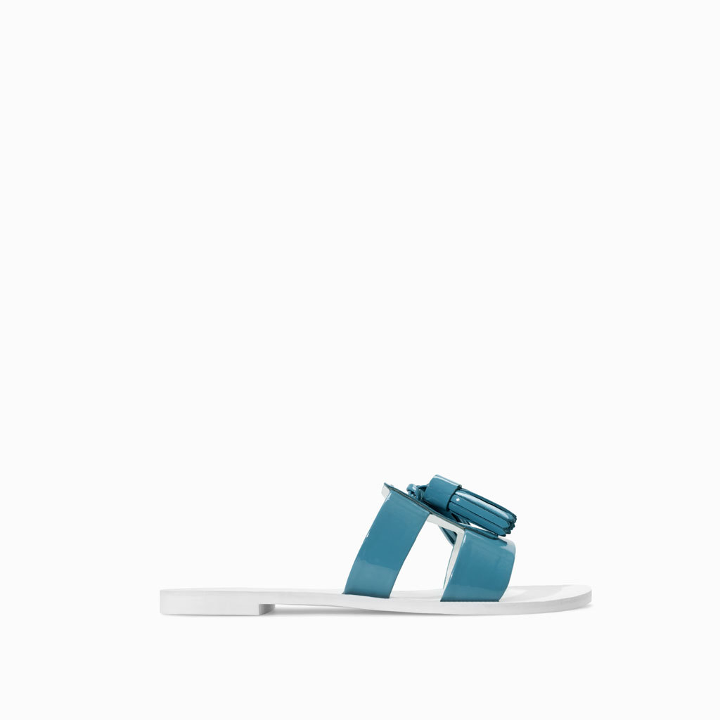 Flat Sandals With Tassels - predominant colour: diva blue; occasions: casual, holiday; material: faux leather; heel height: flat; embellishment: tassels; heel: standard; toe: open toe/peeptoe; style: slides; finish: plain; pattern: plain; season: s/s 2014