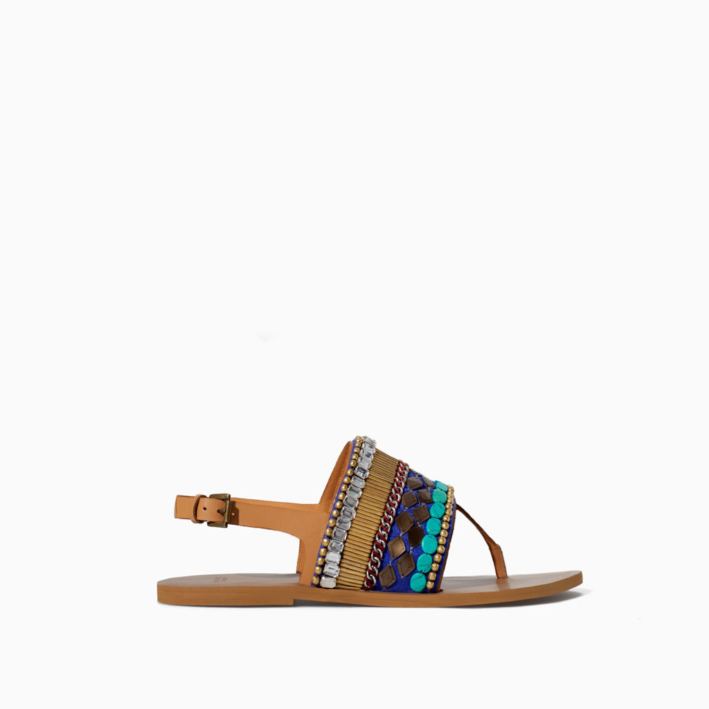 Ethnic Flat Sandal - occasions: casual, holiday; predominant colour: multicoloured; material: leather; heel height: flat; embellishment: beading; heel: standard; toe: toe thongs; style: standard; finish: plain; pattern: plain; season: s/s 2014; multicoloured: multicoloured