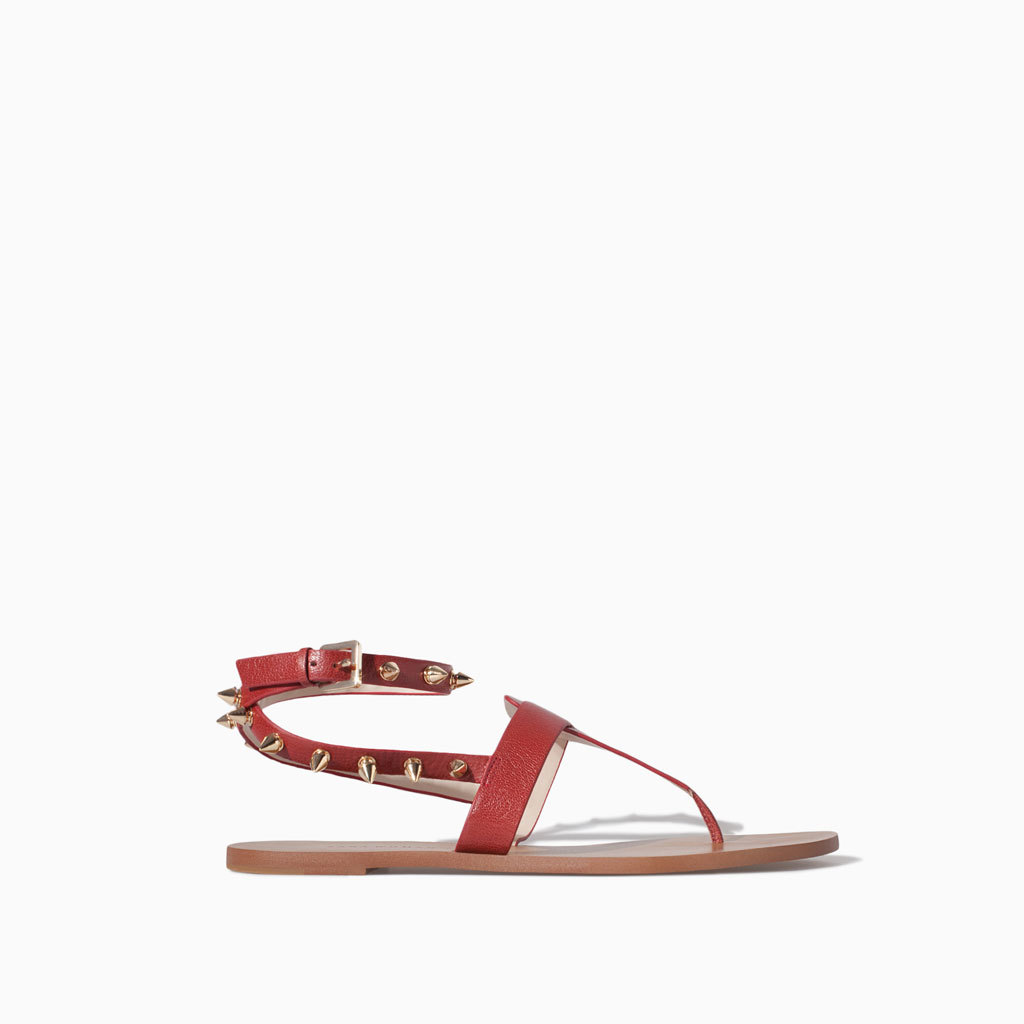 Leather Sandals With Studs - occasions: casual, holiday; material: leather; heel height: flat; embellishment: studs; ankle detail: ankle strap; heel: standard; toe: toe thongs; style: standard; finish: plain; pattern: plain; predominant colour: raspberry; season: s/s 2014