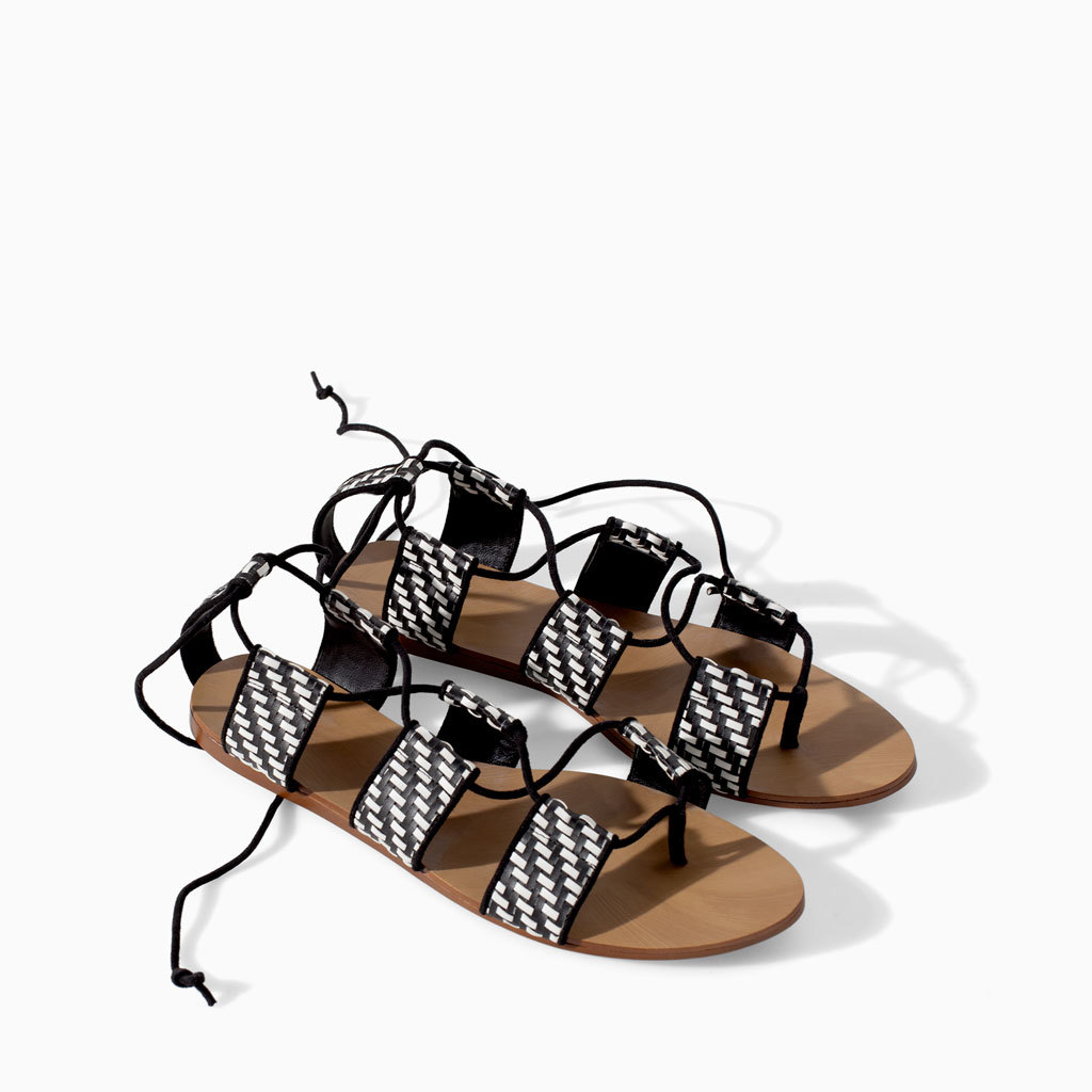 Braided Flat Sole Sandal - secondary colour: white; predominant colour: black; occasions: casual, holiday; material: faux leather; heel height: flat; ankle detail: ankle tie; heel: standard; toe: open toe/peeptoe; style: strappy; finish: plain; pattern: patterned/print; season: s/s 2014; trends: monochrome