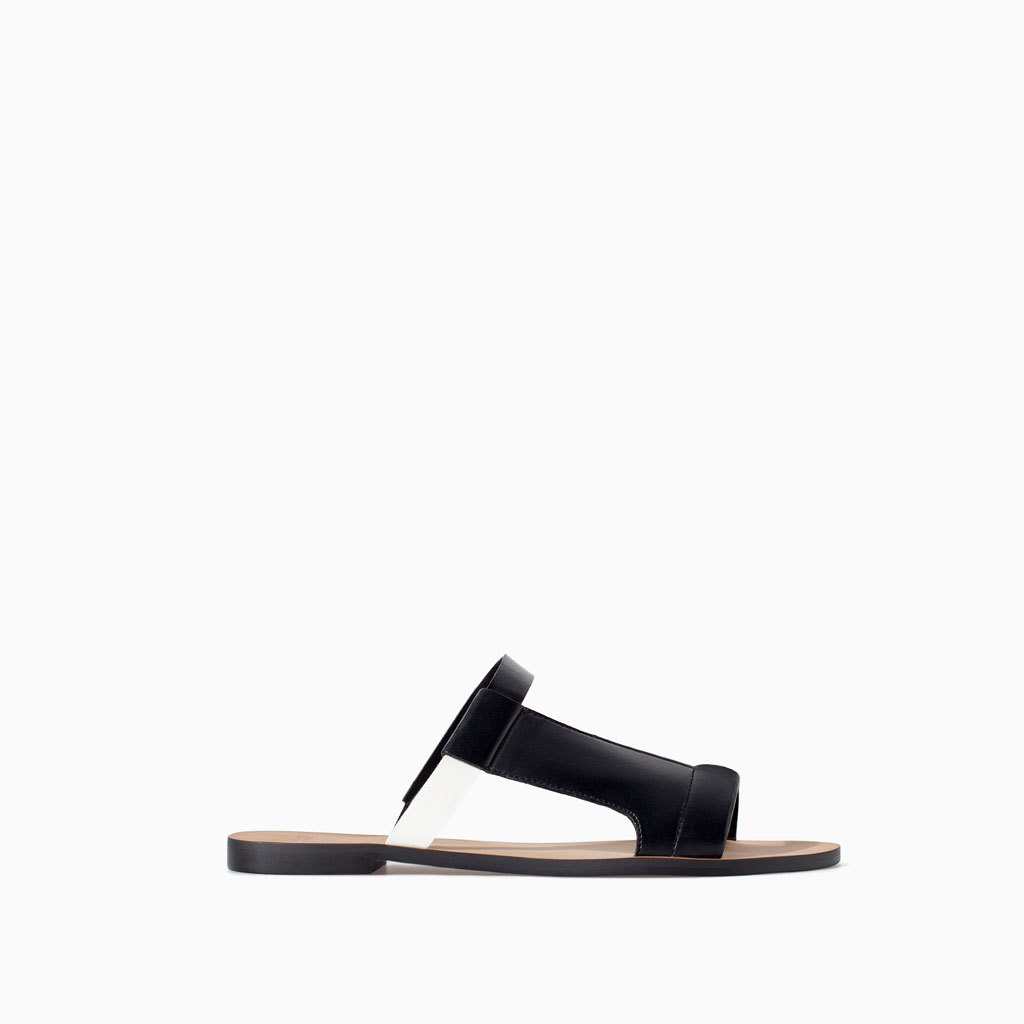 Flat Sandal With Asymmetric Straps - predominant colour: black; occasions: casual, holiday; material: faux leather; heel height: flat; heel: standard; toe: open toe/peeptoe; style: slides; finish: plain; pattern: plain; season: s/s 2014