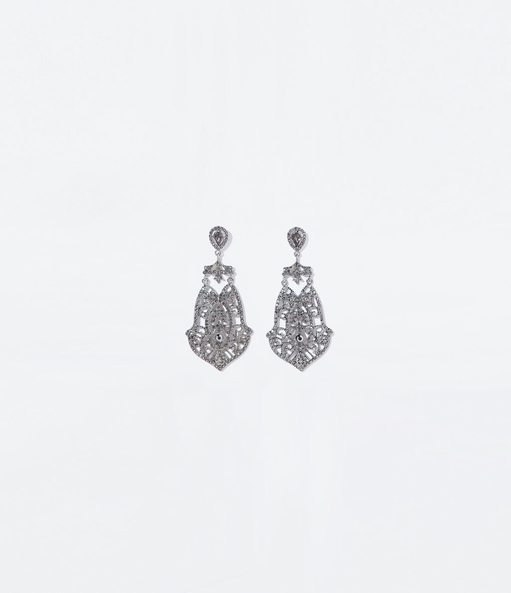 Long Earrings - secondary colour: silver; occasions: evening, occasion; style: chandelier; length: mid; size: standard; material: chain/metal; fastening: pierced; finish: plain; embellishment: crystals/glass; predominant colour: clear; season: s/s 2014
