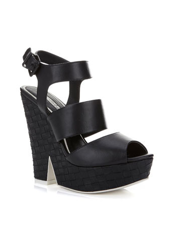 Mystery Weave Wedge - predominant colour: black; occasions: casual, evening, creative work; material: faux leather; ankle detail: ankle strap; heel: wedge; toe: open toe/peeptoe; style: strappy; finish: plain; pattern: plain; heel height: very high; shoe detail: platform; season: s/s 2014; trends: monochrome