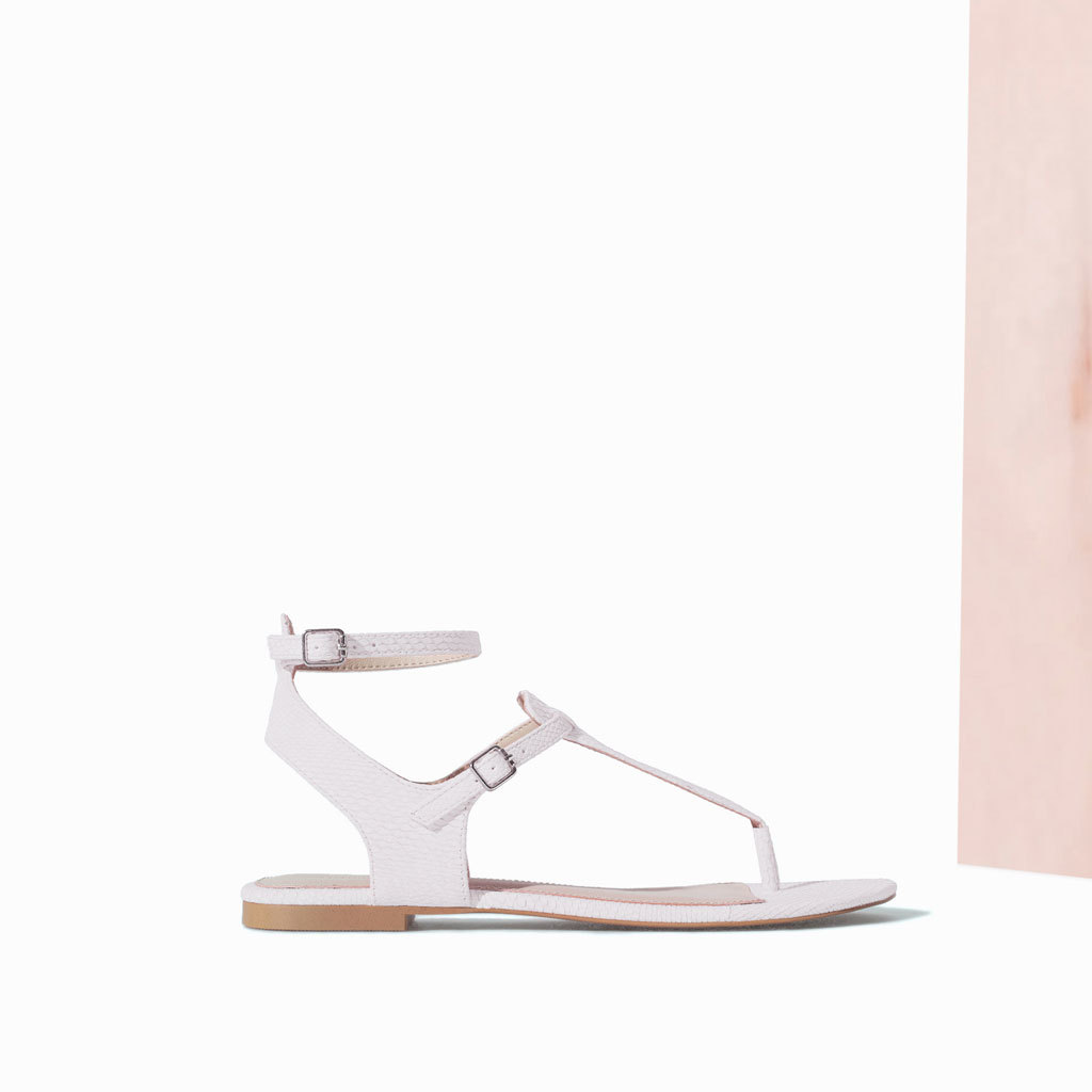 Ankle Strap Sandal - predominant colour: white; occasions: casual, holiday; material: faux leather; heel height: flat; ankle detail: ankle strap; heel: standard; toe: toe thongs; style: strappy; finish: plain; pattern: plain; season: s/s 2014
