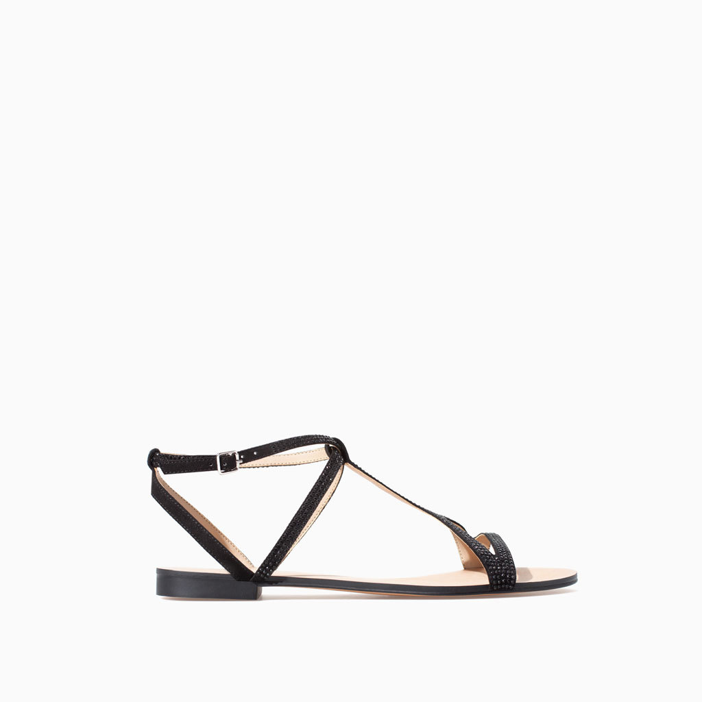 Shiny Sandal - predominant colour: black; occasions: casual, holiday; material: faux leather; heel height: flat; embellishment: jewels/stone; ankle detail: ankle strap; heel: standard; toe: open toe/peeptoe; style: strappy; finish: plain; pattern: plain; season: s/s 2014