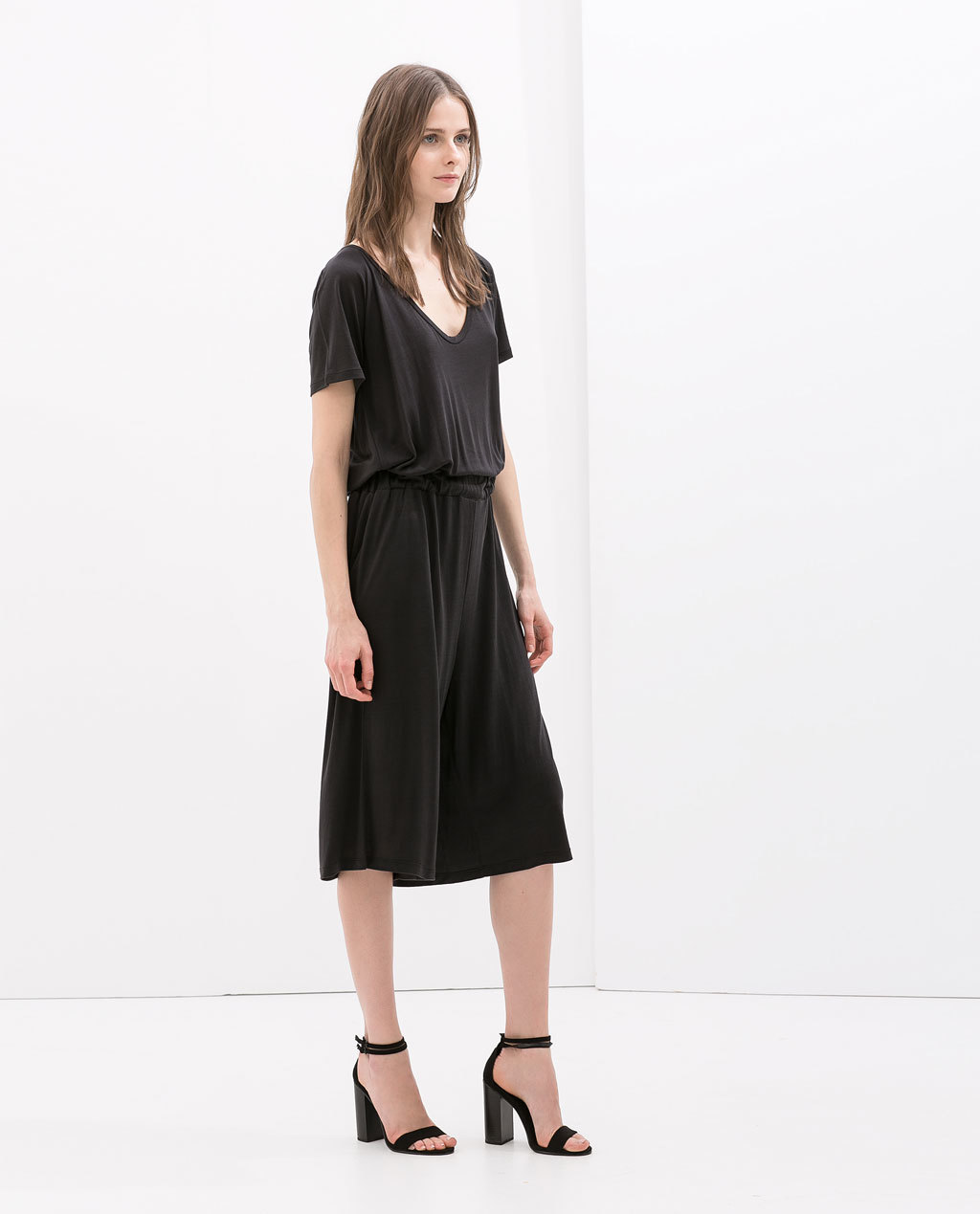 Special Quality Jumpsuit With Cut Outs - neckline: low v-neck; fit: loose; pattern: plain; waist detail: elasticated waist; back detail: back revealing; length: below the knee; predominant colour: black; occasions: casual, evening; fibres: viscose/rayon - 100%; sleeve length: short sleeve; sleeve style: standard; style: jumpsuit; pattern type: fabric; texture group: jersey - stretchy/drapey; season: s/s 2014; wardrobe: highlight