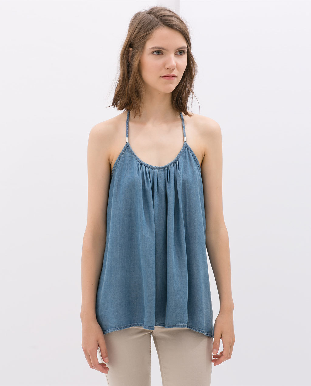 Top With Straps - sleeve style: spaghetti straps; pattern: plain; style: camisole; back detail: low cut/open back; bust detail: ruching/gathering/draping/layers/pintuck pleats at bust; predominant colour: denim; occasions: casual, holiday, creative work; length: standard; neckline: scoop; fibres: cotton - 100%; fit: loose; sleeve length: sleeveless; texture group: denim; pattern type: fabric; season: s/s 2014