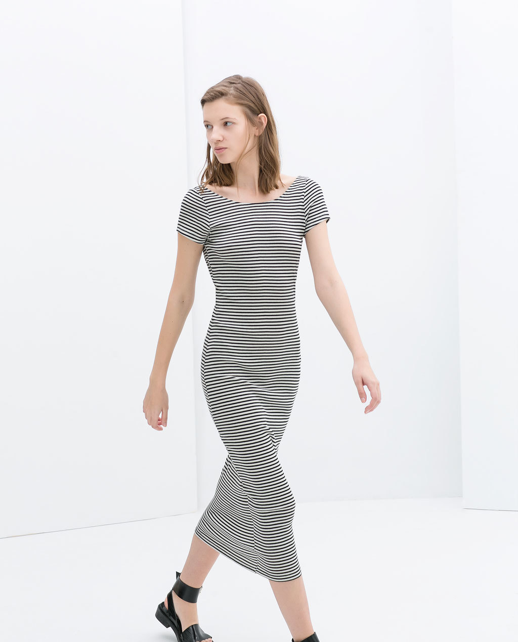 Striped Long Dress With Low Back - style: t-shirt; length: calf length; neckline: round neck; pattern: horizontal stripes; back detail: back revealing; secondary colour: ivory/cream; predominant colour: navy; occasions: casual, evening; fit: body skimming; fibres: cotton - mix; sleeve length: short sleeve; sleeve style: standard; texture group: jersey - clingy; pattern type: fabric; pattern size: standard; season: s/s 2014