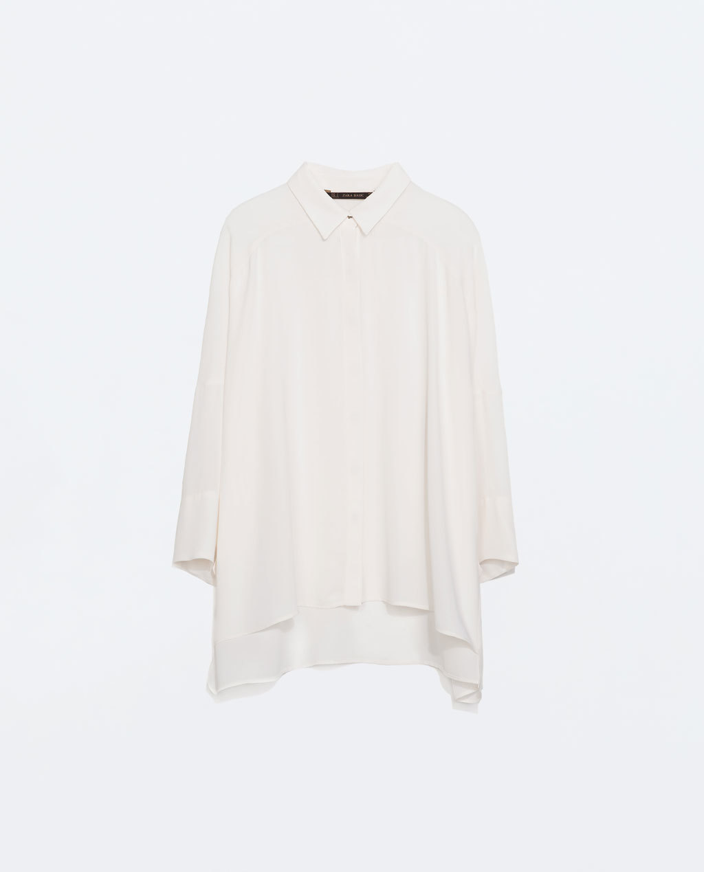 Oversize Blouse With Jewel Button - neckline: shirt collar/peter pan/zip with opening; pattern: plain; length: below the bottom; style: shirt; predominant colour: ivory/cream; occasions: casual, evening, creative work; fibres: polyester/polyamide - 100%; fit: loose; back detail: longer hem at back than at front; sleeve length: long sleeve; sleeve style: standard; texture group: sheer fabrics/chiffon/organza etc.; pattern type: fabric; season: a/w 2014
