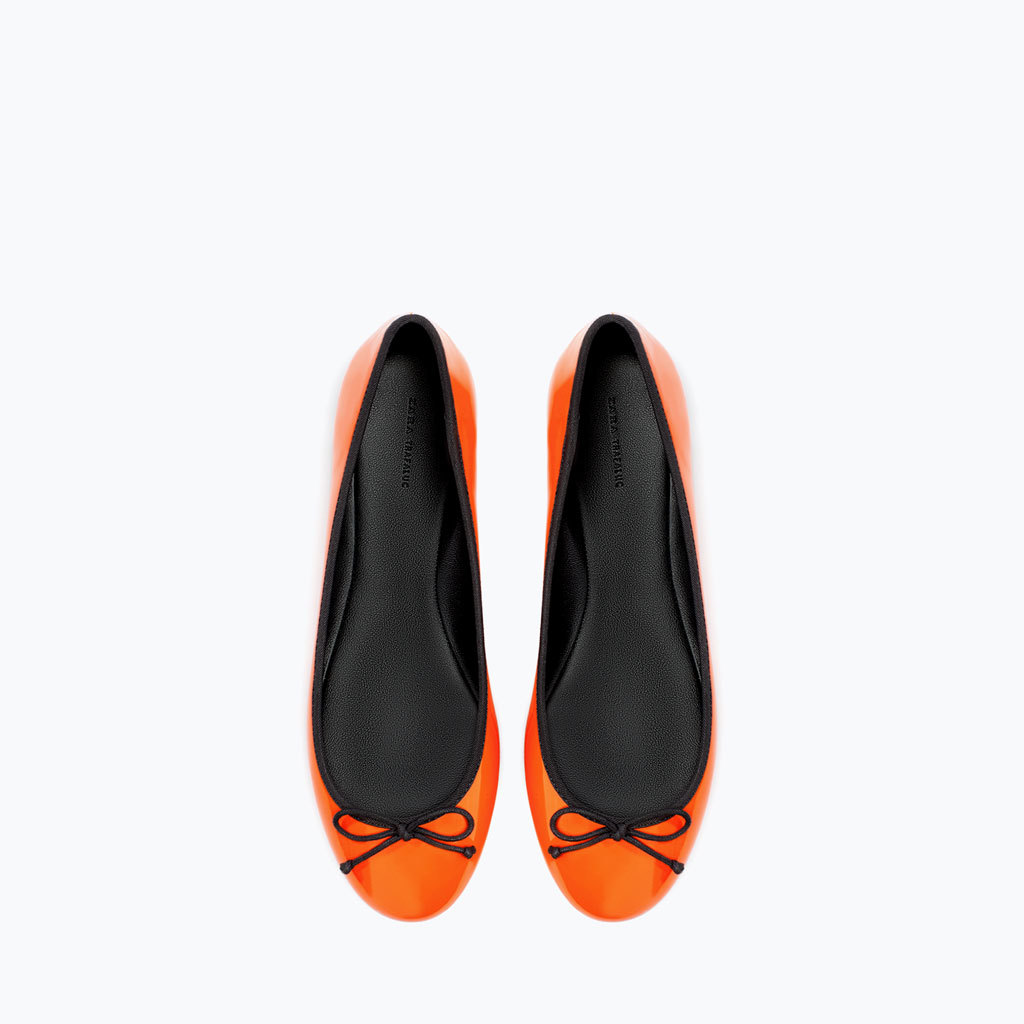 Patent Ballet Flat - predominant colour: bright orange; secondary colour: black; occasions: casual, creative work; material: faux leather; heel height: flat; toe: round toe; style: ballerinas / pumps; finish: patent; pattern: colourblock; trends: zesty shades; season: a/w 2014