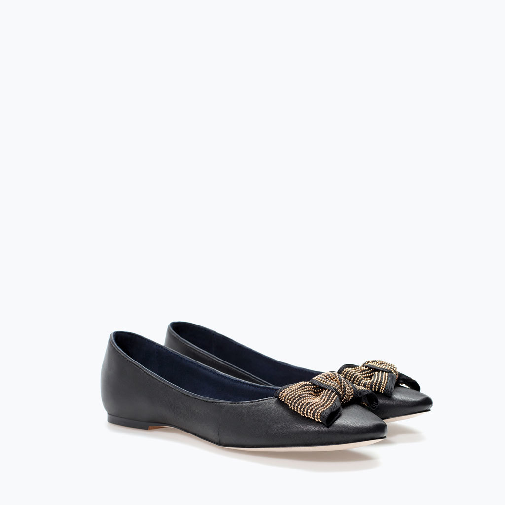 Leather Ballet Flat With Bow - secondary colour: gold; predominant colour: black; occasions: casual, creative work; material: leather; heel height: flat; toe: pointed toe; style: ballerinas / pumps; finish: plain; pattern: plain; embellishment: bow; season: a/w 2014