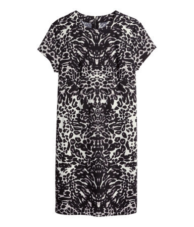 Short Sleeved Jersey Dress - style: shift; length: mid thigh; secondary colour: white; predominant colour: black; occasions: casual, creative work; fit: straight cut; fibres: polyester/polyamide - stretch; neckline: crew; sleeve length: short sleeve; sleeve style: standard; pattern type: fabric; pattern size: standard; pattern: animal print; texture group: jersey - stretchy/drapey; season: a/w 2014