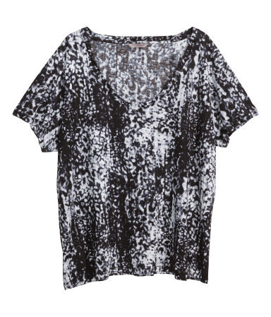 + Patterned Top - secondary colour: white; predominant colour: black; occasions: casual; length: standard; style: top; neckline: scoop; fibres: viscose/rayon - 100%; fit: body skimming; sleeve length: short sleeve; sleeve style: standard; pattern type: fabric; pattern: patterned/print; texture group: jersey - stretchy/drapey; season: a/w 2014; pattern size: big & busy (top)