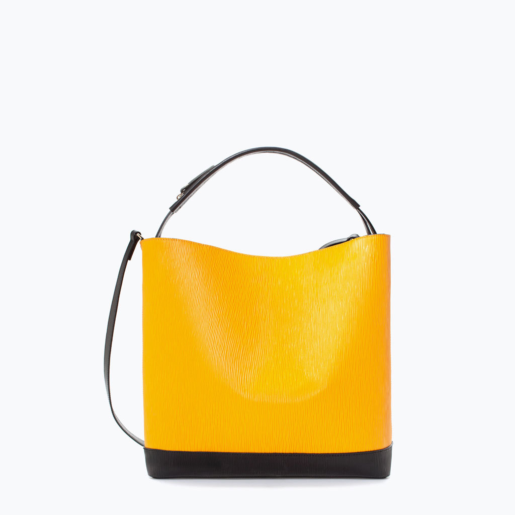 Two Tone Leather Shopper - predominant colour: yellow; secondary colour: black; occasions: casual, creative work; type of pattern: standard; style: tote; length: handle; size: standard; material: leather; finish: plain; pattern: colourblock; trends: zesty shades; season: a/w 2014