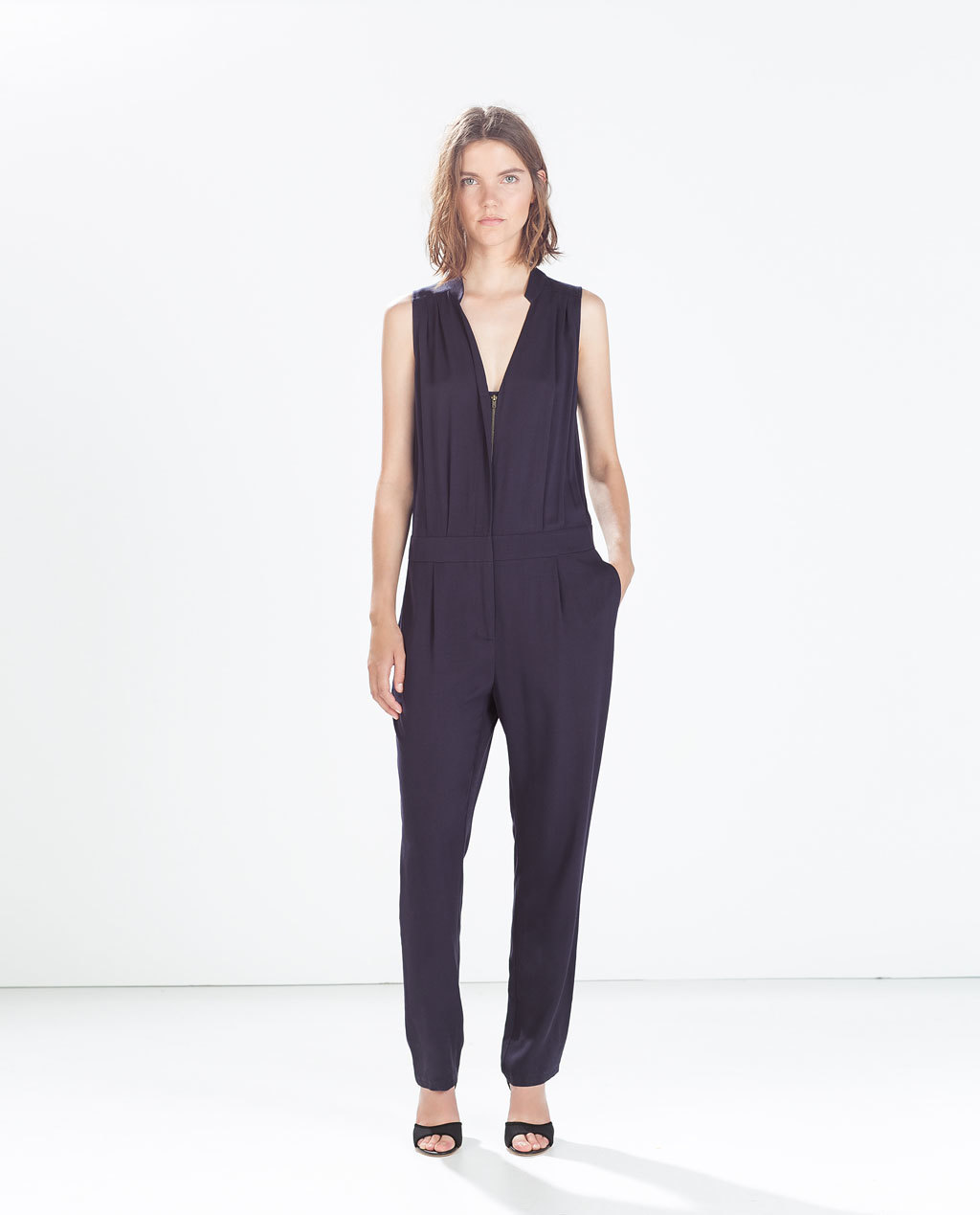 Long Jumpsuit With Zip Neckline - length: standard; neckline: low v-neck; pattern: plain; sleeve style: sleeveless; hip detail: side pockets at hip; predominant colour: navy; occasions: evening; fit: body skimming; fibres: viscose/rayon - 100%; sleeve length: sleeveless; style: jumpsuit; pattern type: fabric; texture group: other - light to midweight; season: a/w 2014
