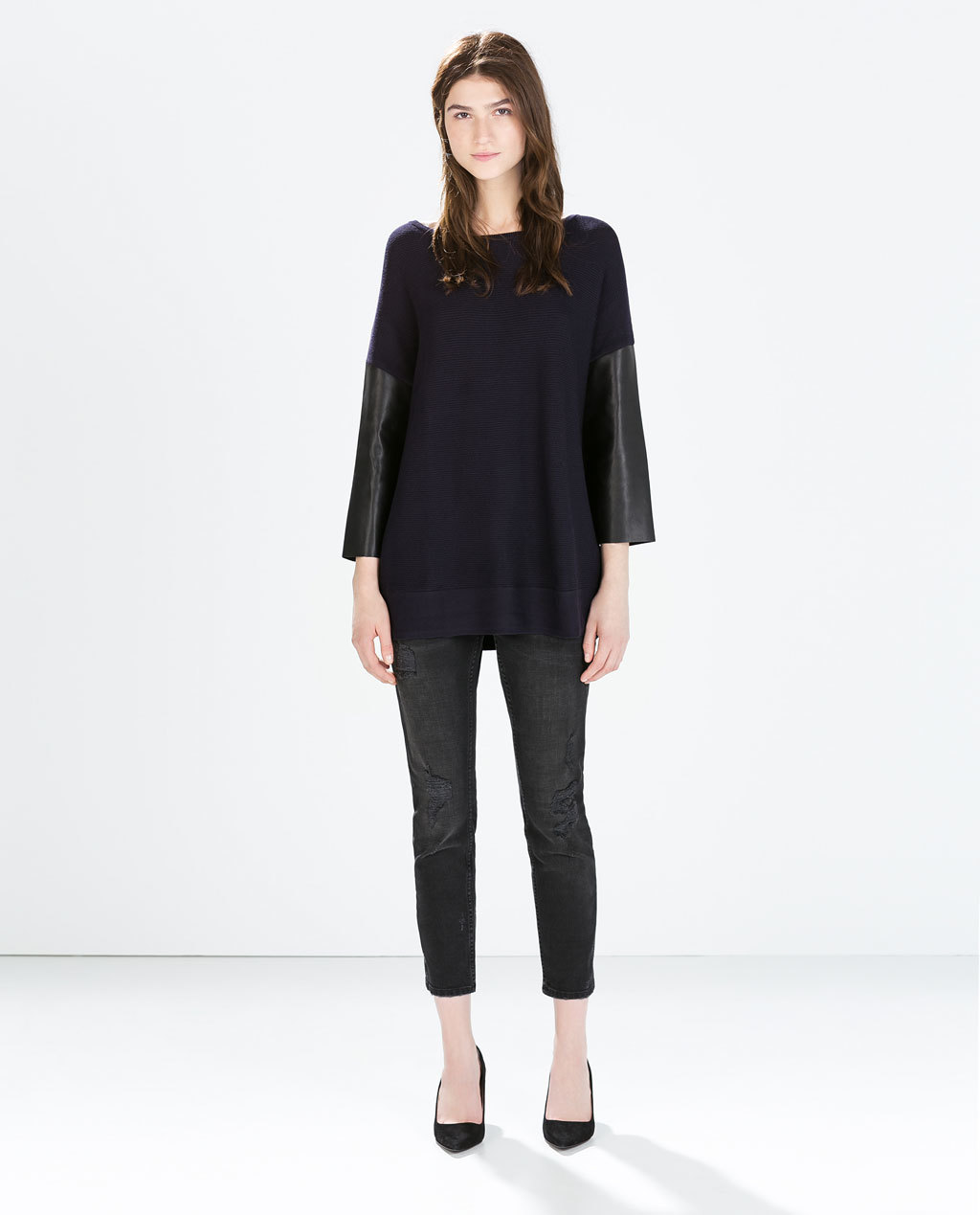 Sweater With Faux Leather Sleeves - neckline: slash/boat neckline; length: below the bottom; style: tunic; predominant colour: black; secondary colour: black; occasions: casual, creative work; fit: loose; back detail: longer hem at back than at front; sleeve length: 3/4 length; sleeve style: standard; texture group: knits/crochet; pattern type: fabric; pattern: colourblock; fibres: viscose/rayon - mix; season: a/w 2014