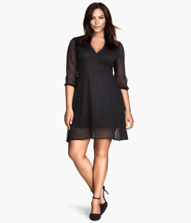 + Spotted Dress - length: mid thigh; neckline: low v-neck; pattern: plain; predominant colour: black; occasions: evening, occasion; fit: fitted at waist & bust; style: fit & flare; fibres: polyester/polyamide - 100%; sleeve length: 3/4 length; sleeve style: standard; texture group: sheer fabrics/chiffon/organza etc.; trends: minimal sleek; season: a/w 2014