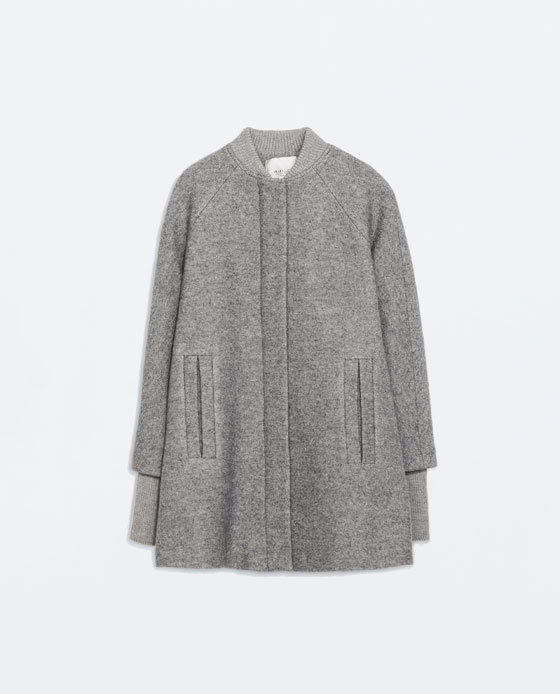 Knit Cape With Sleeves - style: single breasted; collar: high neck; length: mid thigh; predominant colour: light grey; occasions: casual, creative work; fit: straight cut (boxy); fibres: wool - mix; sleeve length: long sleeve; sleeve style: standard; collar break: high; texture group: woven light midweight; pattern: marl; trends: outerwear chic; season: a/w 2014