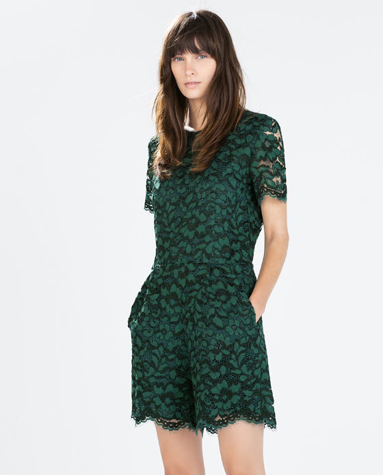 Lace Jumpsuit - neckline: round neck; fit: fitted at waist; length: mid thigh shorts; predominant colour: emerald green; occasions: casual, evening, occasion; sleeve length: short sleeve; sleeve style: standard; texture group: lace; style: playsuit; pattern: patterned/print; fibres: viscose/rayon - mix; embellishment: lace; trends: zesty shades; season: a/w 2014