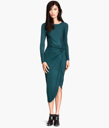 Jersey Dress - length: below the knee; neckline: round neck; fit: tight; pattern: plain; waist detail: flattering waist detail; predominant colour: teal; occasions: evening; style: asymmetric (hem); fibres: viscose/rayon - stretch; sleeve length: long sleeve; sleeve style: standard; texture group: jersey - clingy; trends: zesty shades; season: a/w 2014