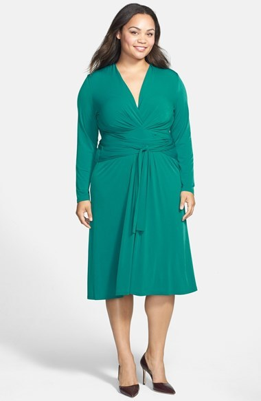Faux Wrap Jersey Dress (Plus Size) - style: faux wrap/wrap; length: below the knee; neckline: low v-neck; pattern: plain; waist detail: twist front waist detail/nipped in at waist on one side/soft pleats/draping/ruching/gathering waist detail; predominant colour: emerald green; occasions: evening, occasion, creative work; fit: fitted at waist & bust; fibres: polyester/polyamide - stretch; sleeve length: long sleeve; sleeve style: standard; texture group: jersey - clingy; pattern type: fabric; season: a/w 2014